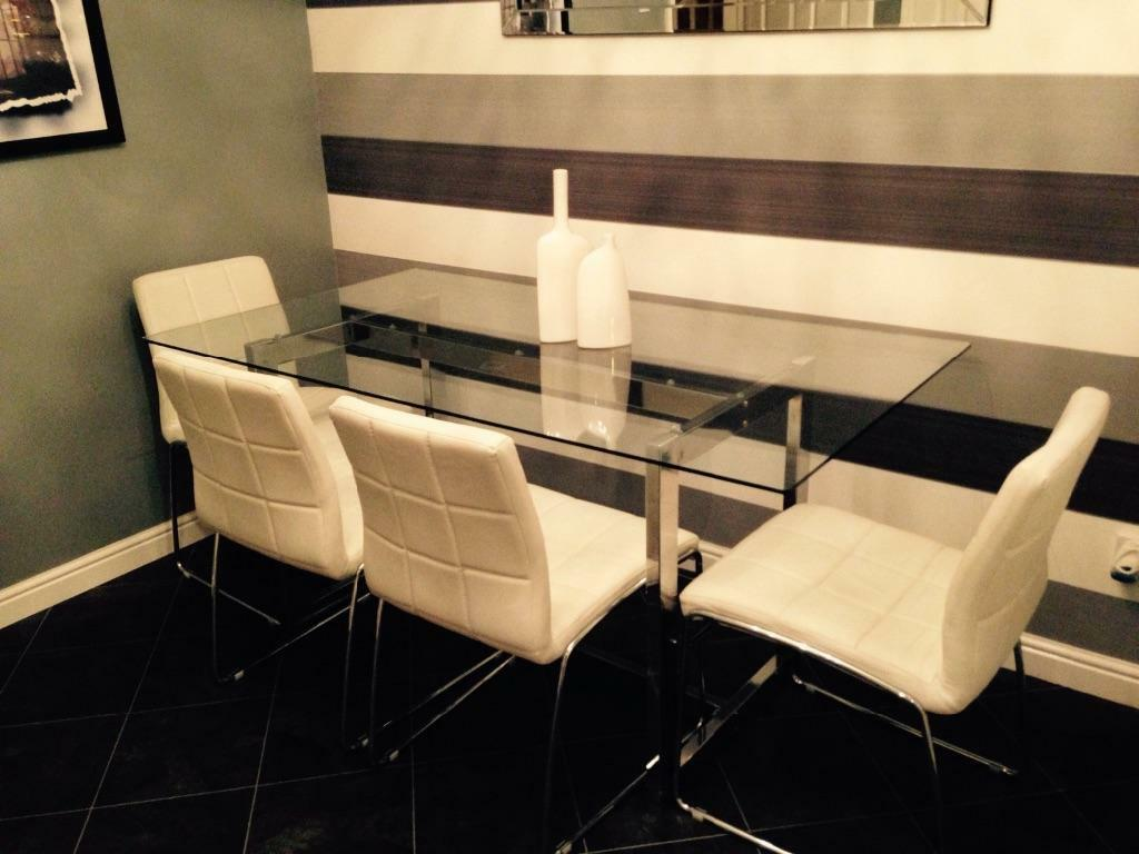 Next glass dining room table with 4 chairs in motherwell for Dining room tables next