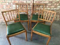 Four mid century dinning chairs