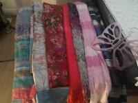 Bundle of long scarves and scarf hanger