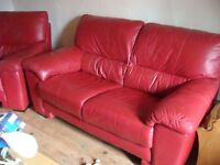 Red leather 2 seater sofa 2 armchairs (1 electric recliner) and poufee with storage