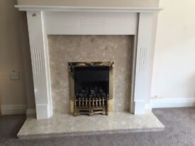 Gas fire with stone plinth and wooden surround