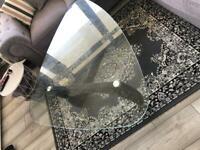 Living room / dinning room glass coffee table.