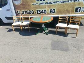 Tike top dining room table and 4 chairs £79