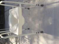 Disabled toilet seat on frame, adjustable height, arms