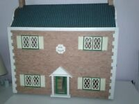 dolls house with some furniture