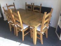Quality solid wooden table and 6 chairs