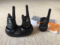 Three 'walkie talkie' hand held two-way radio sets, Motorola T5422 x2 and one Motorola T6222
