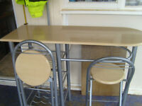 breakfast bar with 2 chairs
