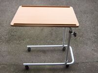 OVERBED TABLE ON CASTERS>ADJUSTABLE HEIGHT AND CAN BE TILTED