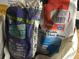 Brand new blue tiles, 2 bags of opened charcoal-coloured tiling grout and drying dividers
