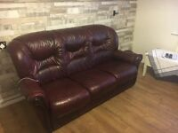 Beautiful burgundy Sofa with 2 matching armchairs