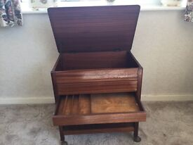 Large wooden sewing and knitting box on wheels
