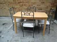 Light wood table & 4 chairs (seat covers need a wash)