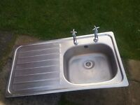 Kitchen sink with tops
