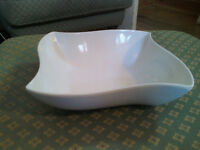 Plastic, maybe melamine Thorntons serving display dish