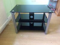 For sale: TV Stand black glass. Measuring L70cm, D42cm,H50cm. Good condition.