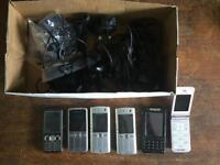 Old phones and various cables flip phone Nokia Sony Ericsson 90s phone
