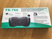 Wireless keyboard with integrated mouse (trackball)