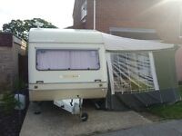4 Berth Caravan with Awning - Aged but still has a few trips in her! Good & cheap starter van.
