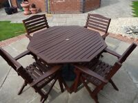 OCTAGONAL WOODEN GARDEN TABLE AND FOUR CHAIRS