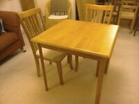Dining table and 2 chairs. Perfect for two.