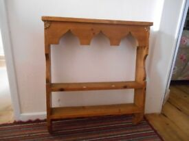 Beautiful wooden plate/display rack with fine detailing.