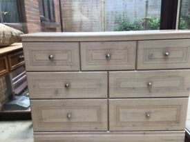 A large light wood set of drawers with 3 small and 4 large ones. Amazing place to store your goods.