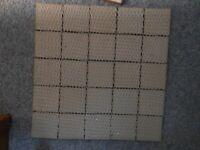 3 no. panels of small ceramic tiles