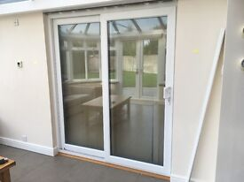 Sliding PVC patio doors with frame, for sale keys included in sale.