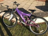 "Concept Breeze, Dual Suspension; 14"" Purple Frame; 18 Gripshift Gears"