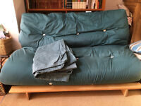 Double futon in excellent condition with spare cover