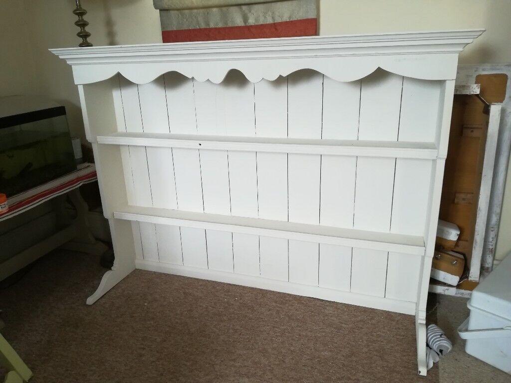 Plate rack. Dresser top. We used it in hallway to display photos on. Painted annie sloane