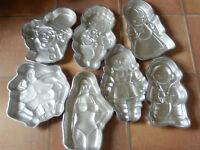 set of 7 Wilton figure tins: Superman,Baby,Rag doll, Fireman, Female Torso, Clown,Little Girl+cake