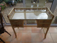 Glass topped cane ladies dressing table.