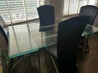 Extendable 6 seater dining table and 4 chairs