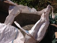 White washed sharp gravel as decorative or as filler on its own or within cement mix.