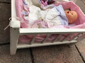 Dolls, cot and clothes