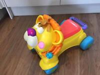 Fisher price ride on lion and walker with music and lighta