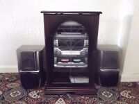 hi fi system in cabinet with speakers