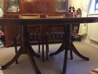 Oval shaped dining table and 4 chairs