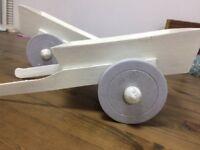 White mini wooden wheel barrows for wedding sweet table (homemade).