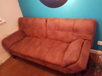 ALMOST NEW SOFA BED Brown Swede type leather. Fantastic condition. Drops flat into a double bed