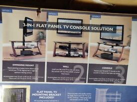 Brand new Oak and glass TV stand in box.