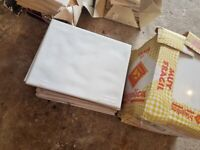 White ceramic tiles with gentle contour surface