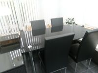 Glass dining table and 4 chairs excellent condition bargain £80