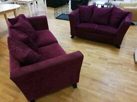 Plum/maroon 3 and 2 seater sofas with scatterback cushions