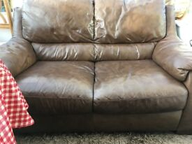 Brown two seater sofa