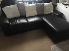 Black leather corner chaise sofa, £60.00