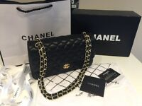 Chanel 2.55 bag. Black leather gold chain
