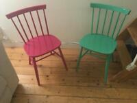 Spindle-back pink and green chairs